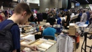 In this file image, a comic book fan flips through some comics at the Central Canada Comic-Con on Nov. 2, 2013.