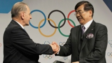 International Olympic Committee President Jacques Rogge, left, shakes hand with South Korea's Olympic Bid chairman Cho Yang-ho, right, after a signing the host city contract for the 2018 Winter Olympics in Durban, South Africa, Wednesday July 6, 2011. (AP / Themba Hadebe)