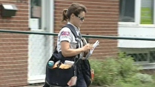 Canada Post mail carrier Rebekah Mahar is seen working in a residential neighbourhood on Wednesday, July 6, 2011.