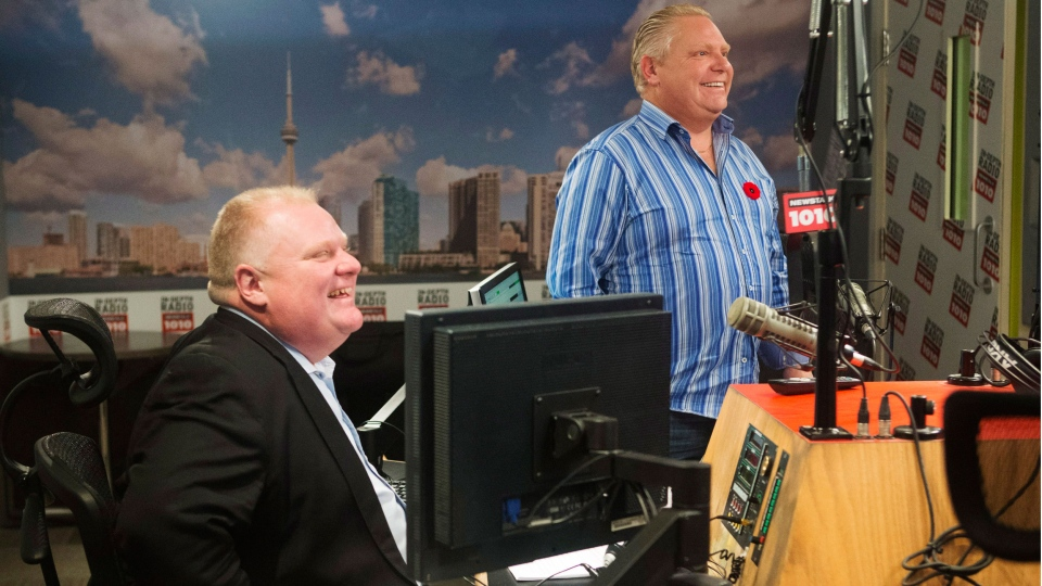 Toronto Mayor Rob Ford and his brother, Toronto city councillor Doug Ford, right, appear on a radio show in Toronto, Sunday November 3, 2013. (Mark Blinch / THE CANADIAN PRESS)