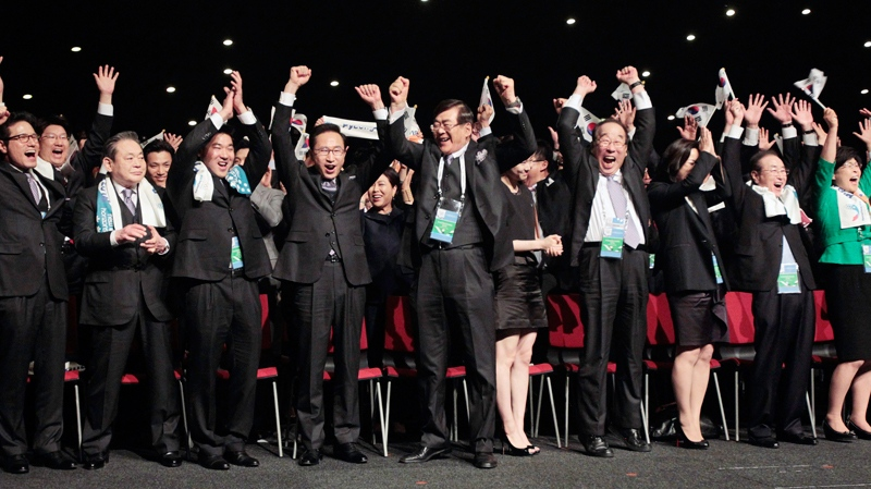 Members of the South Korean delegation react after the IOC announced it voted for Pyeongchang to be the host city for the 2018 Winter Olympics, Wednesday July 6, 2011. (AP / Jerome Delay)