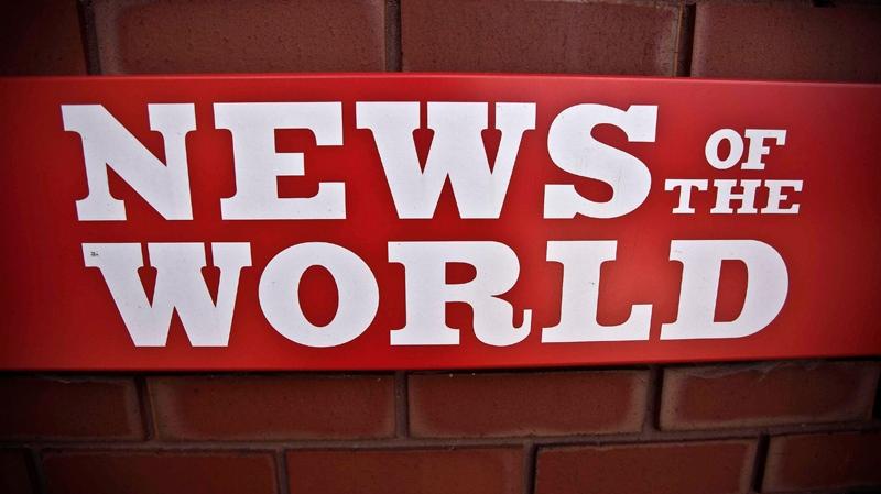 A News of the World sign is seen by an entrance to a News International building in London, Wednesday, July 6, 2011. (AP / Matt Dunham)