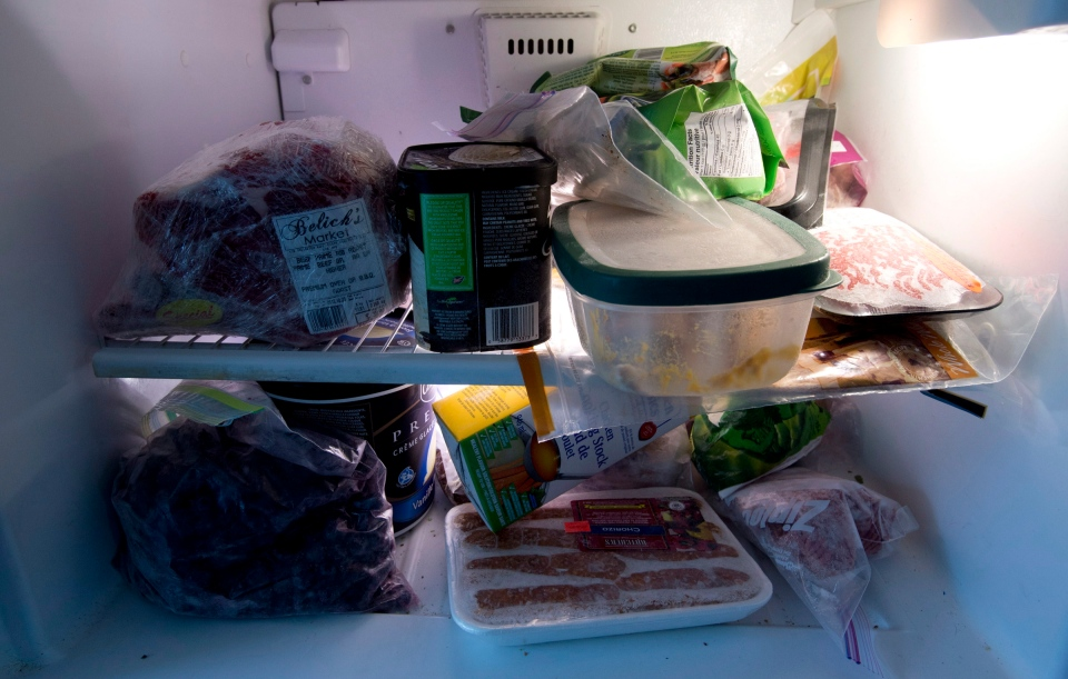 Food is shown in a freezer in North Vancouver, B.C., Wednesday, Oct. 30, 2013. (Jonathan Hayward / THE CANADIAN PRESS)