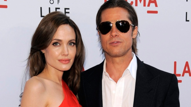 Brad Pitt and Angelina Jolie arrive at a screening of 'Tree of Life, Tuesday, May 24, 2011, in Los Angeles. (AP / Chris Pizzello)