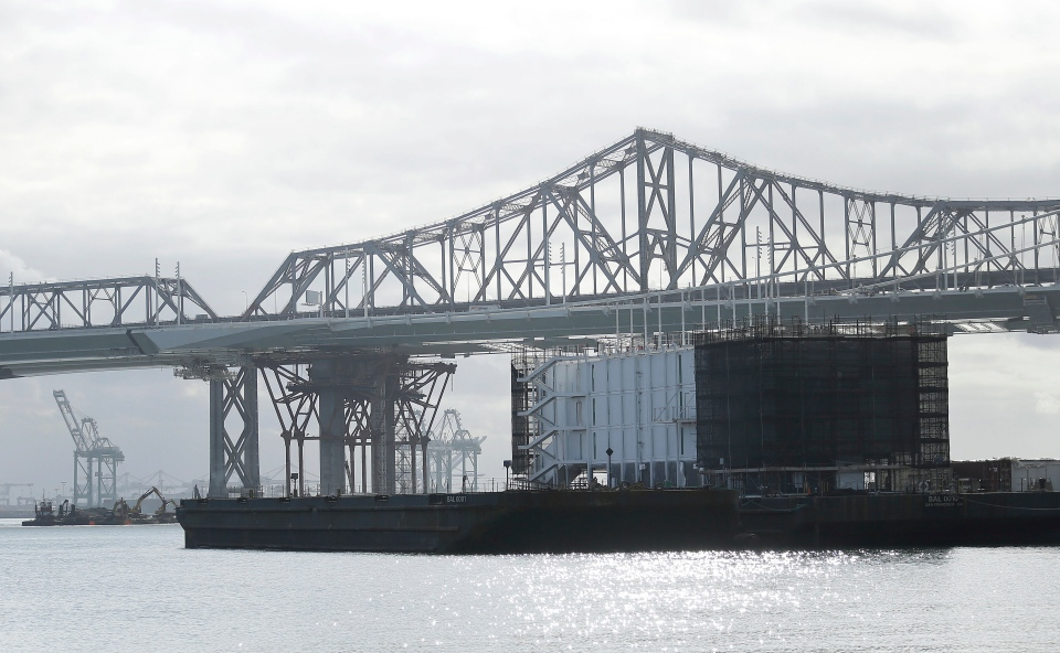 This photo shows a barge on Treasure Island with the eastern span of the San Francisco-Oakland Bay Bridge at rear in San Francisco, Tuesday, Oct. 29, 2013. The barge is one of three mysterious floating structures that have sparked online speculation. The secretive structures, two in San Francisco and one Portland, Maine, are registered with a Delaware corporation as BAL0001, BAL0010, BAL0011 and BAL0100. (AP Photo/Jeff Chiu)