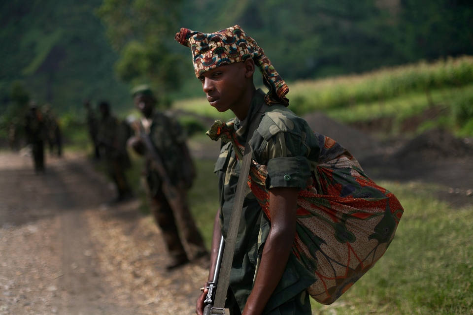FILE - In this Nov. 30, 2012 file photo, M23 rebels withdraw from the Masisi and Sake areas in the eastern Congo town of Sake, some 27 kilometers west of Goma, Congo. (AP Photo/Jerome Delay, File)