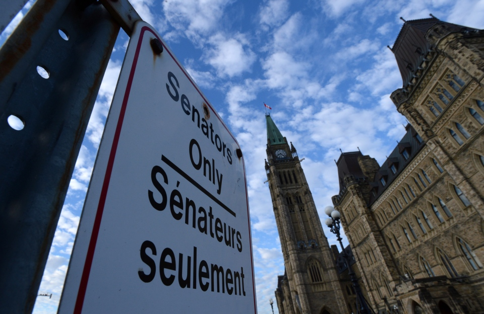 A 'Senators Only' parking sign is displayed on Parliament Hill in Ottawa on Tuesday, Nov.r 5, 2013. (Sean Kilpatrick / THE CANADIAN PRESS)