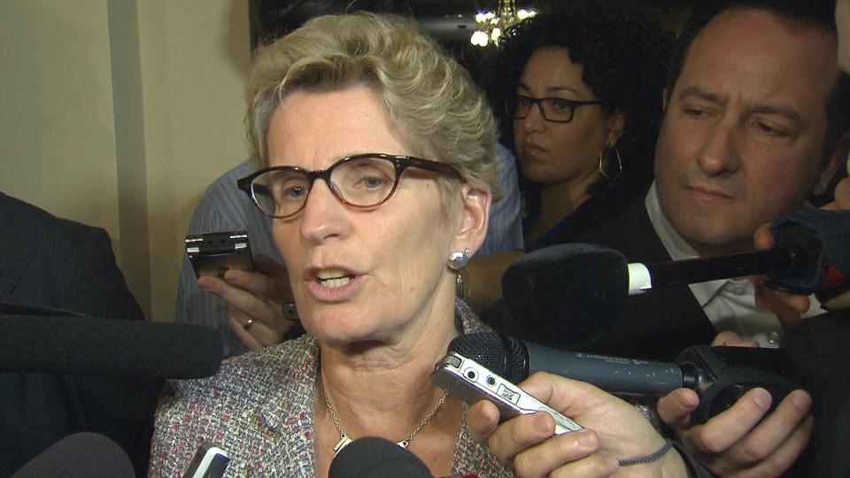 Ontario Premier Kathleen Wynne speaks to reporters at Queen's Park in Toronto, Tuesday, Nov. 5, 2013.