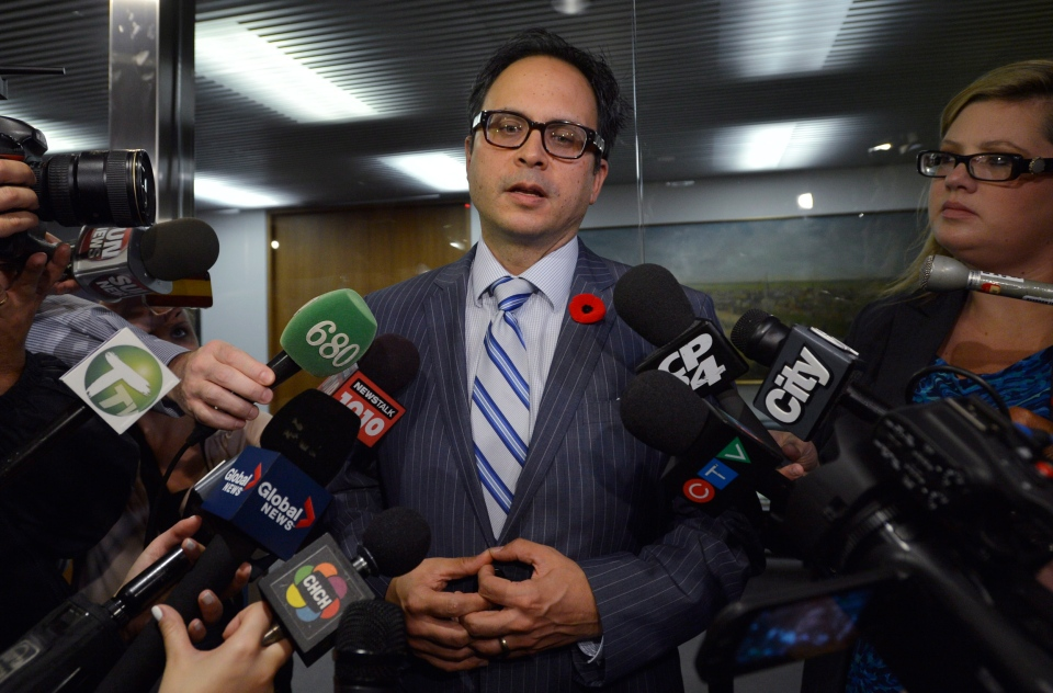 Toronto city councillor Denzil Minnan-Wong comments on Mayor Rob Ford's admission that he smoked crack cocaine, at City Hall in Toronto, Tuesday, Nov. 5, 2013. (Nathan Denette / THE CANADIAN PRESS)