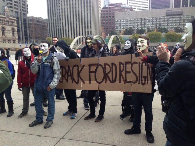 Protesters gather outside Toronto City Hall, calling for Mayor Rob Ford to resign, Tuesday, Nov. 5, 2013. (Danny Pinto / CTV Toronto)
