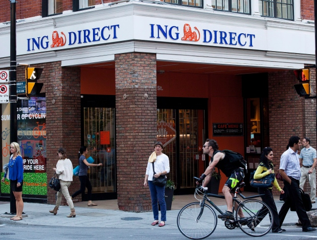 People walk by an ING Direct cafe in Toronto following the announcement that ING Bank of Canada will be acquired by Scotiabank on Wednesday, August 29, 2012. (Michelle Siu / THE CANADIAN PRESS)