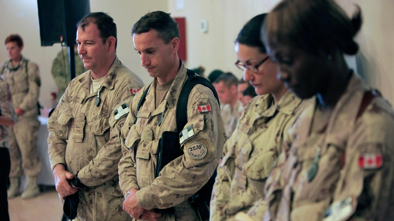Canadian soldiers pay tribute to the fallen soldiers during a transfer of command authority ceremony in Kandahar airbase in Afghanistan, Thursday, July 7, 2011. (AP / Rafiq Maqbool)
