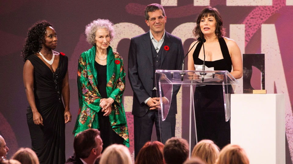 Giller Prize winner Lynn Coady speaks beside jury members Jonathan Lethem, centre, Margaret Atwood, centre left, and Esi Edugyan, left after winning the award for her book 'Hellgoing,' in Toronto, Tuesday, Nov. 5, 2013. (Mark Blinch / THE CANADIAN PRESS)