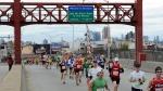 Runners cross over the Pulaski Bridge into the Queens borough of New York during the New York City Marathon on Sunday, Nov. 3, 2013. (AP / Kathy Kmonicek)