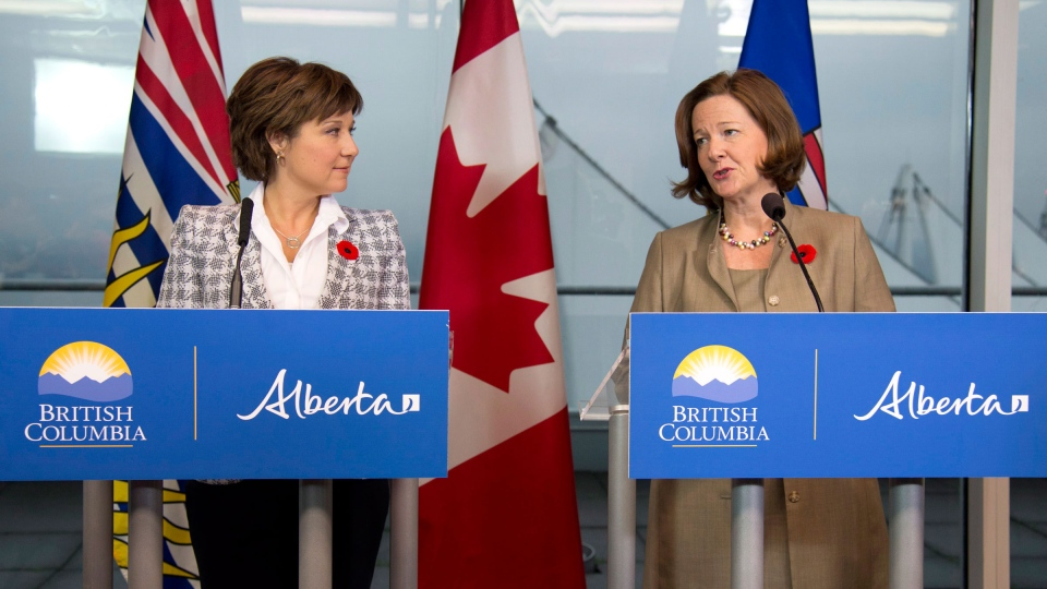 B.C. Premier Christy Clark (left) and Alberta Premier Alison Redford address a news conference in Vancouver, Tuesday, Nov.5, 2013. (Jonathan Hayward / THE CANADIAN PRESS)