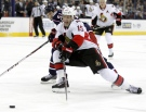 Ottawa Senators' Zack Smith, right, reaches for the puck against Columbus Blue Jackets' Fedor Tyutin of Russia in the first period of an NHL hockey game in Columbus, Ohio, Tuesday, Nov.5, 2013. (AP Photo/Paul Vernon)