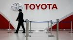 An employee of Toyota Motor Corp. prepares for an event at Mega Web, a renewed Toyota gallery in Tokyo Wednesday, Nov. 6, 2013.(AP Photo/Junji Kurokawa)