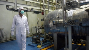 An Iranian technician walks through the Uranium Conversion Facility just outside the city of Isfahan 410 kilometres south of the capital Tehran, Iran on Feb. 2007.  (AP / Vahid Salemi)