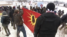 Aboriginal protesters march at the site of a land-claim dispute in Caledonia, Ont. on Sunday, Feb. 27, 2011.