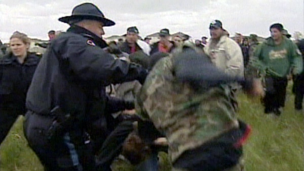 Aboriginal protesters clash in Caledonia, Ont. in this undated image taken from video.