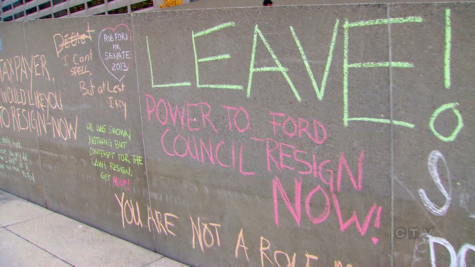 Protesters calling for Toronto Mayor Rob Ford to step aside leave messages outside of city hall in Toronto on Wednesday, Nov. 6, 2013.