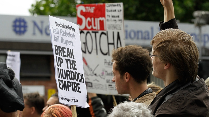 Protesters demonstrate against the News of the World newspaper outside News International's headquarter in London, Friday, July 8, 2011. (AP / Sang Tan)
