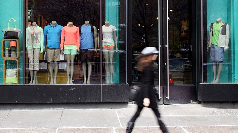 In this Tuesday, March 19, 2013, file photo, a woman walks past the Lululemon Athletica store at Union Square in New York. (AP Photo/Mary Altaffer, File)