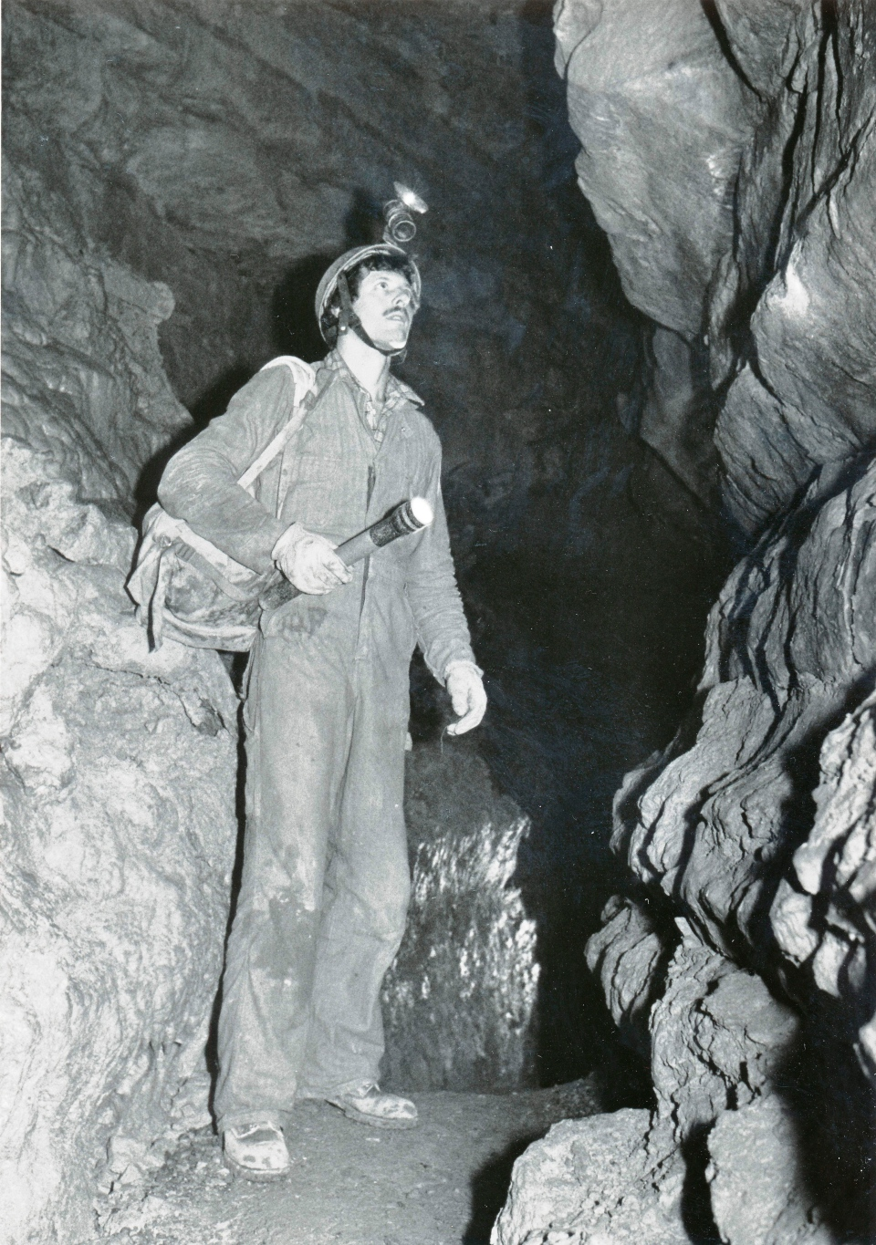 In this 1980's photo provided by John Ackerman, Ackerman stands inside his Spring Valley Caverns near Spring Valley, Minn. Ackerman, who has discovered various caves in the area that he is helping preserve, plans to be buried inside the cave when he dies. (AP Photo/Courtesy John Ackerman)