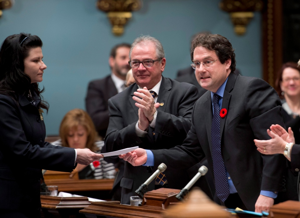 Quebec Minister Responsible for Democratic Institutions and Active Citizenship Bernard Drainville, right, tables legislation on secularism for the government at the legislature in Quebec City, Thursday, Nov. 7, 2013. (Jacques Boissinot / THE CANADIAN PRESS)