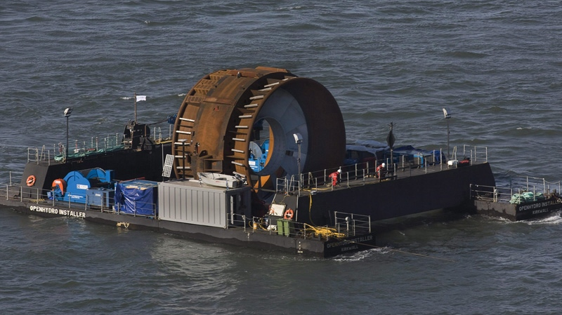 Technicians prepare to deploy the first commercial in-stream tidal turbine in the Bay of Fundy near Parrsboro, N.S. on Thursday, Nov. 12, 2009. (THE CANADIAN PRESS/Andrew Vaughan)