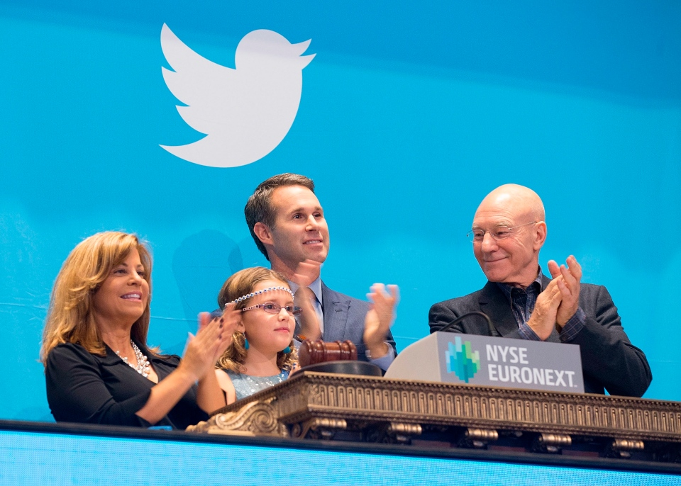 Bureau Chief of Public Information for the Boston Police Department Cheryl Fiandaca, left, Vivienne Harr, a girl who sells lemonade in the name of ending slavery across the globe, NYSE Executive Vice President Scott Cutler, and actor Sir Patrick Stewart, right, applaud the New York Stock Exchange opening bell is rung for the Twitter IPO, Thursday, Nov. 7, 2013. (Ben Hider, NYSE)