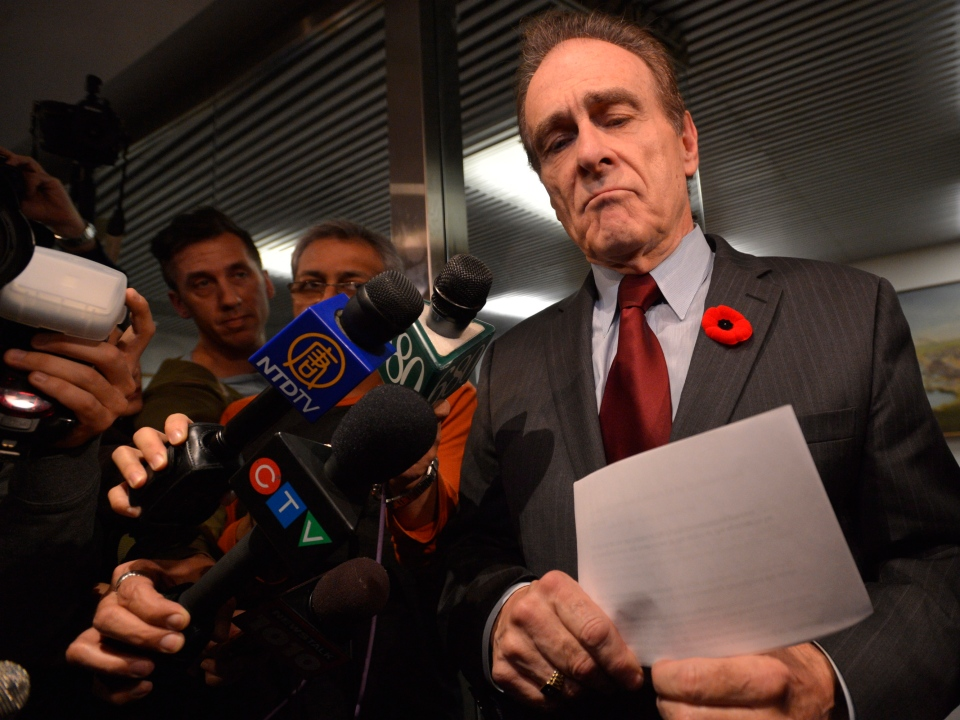 Toronto City Deputy Mayor Norm Kelly leaves a meeting after having a 'good talk' with Mayor Rob Ford at Toronto's city hall on Thursday, Nov. 7, 2013. (Nathan Denette / THE CANADIAN PRESS)