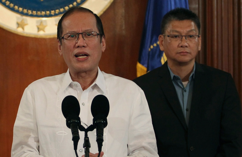 Philippine President Benigno Aquino III, left, speaks about Typhoon Haiyan during a nationally televised address at the Malacanang palace in Manila, Philippines on Thursday Nov. 7, 2013. (Malacanang Photo Bureau / Robert Vinas)