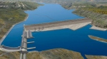 An artists rendering depicts the proposed Site C dam and hydroelectric generating station on B.C.'s Peace River. (BCHydro.com)