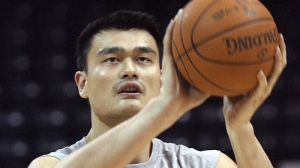 In this Oct. 2010 file photo, the Houston Rockets' Yao Ming warms up for a preseason game in Hidalgo, Texas (AP Photo/Delcia Lopez)