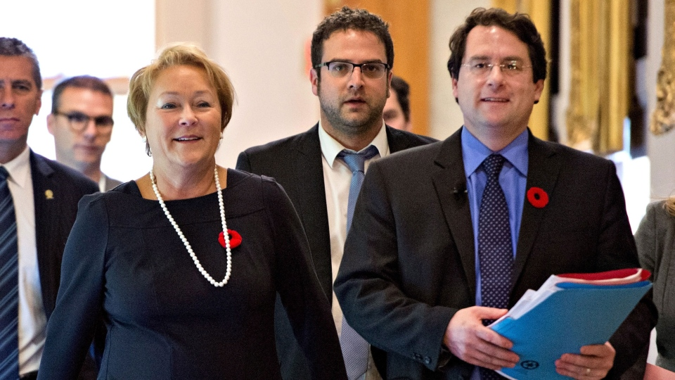 Quebec Premier Pauline Marois, left, and Bernard Drainville, minister responsible for Democratic Institutions and Active Citizenship walk to a news conference after the government tabled a legislation on secularism for the government, at the legislature in Quebec City, Thursday, Nov. 7, 2013. (Jacques Boissinot / THE CANADIAN PRESS)