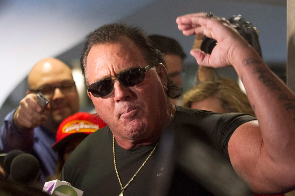 "Brutus ""The Barber"" Beefcake speaks to the media outside Toronto City Mayor Rob Ford's office on Thursday, Nov. 7, 2013. (Chris Young / THE CANADIAN PRESS)"