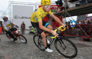 In this July 31, 2013 file photo, Team Sky rider and 2013 Tour de France winner, Christopher Froome, right, of Britain participates in the Derny Criterium race in Antwerp, Belgium. (AP Photo/ Peter Deconinck)