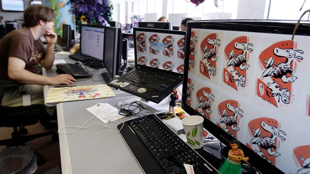 "In this June 2, 2011 photo, an employee works on the Zynga game, ""FarmVille"" at Zynga headquarters in San Francisco. Based on papers filed Friday, July1, 2011, Zynga, the online game maker behind ""FarmVille"" and other popular Facebook pastimes, is going public. (AP Photo/Paul Sakuma)"