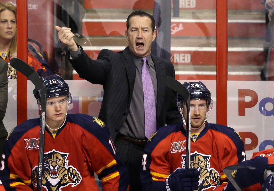 In this Oct. 13, 2013, file photo, Florida Panthers head coach Kevin Dineen calls out to players during the first period of a game against the Los Angeles Kings in Sunrise, Fla. (AP Photo/Wilfredo Lee, File)