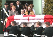 Family and friends of Cpl. Kevin Megeney watch as his casket is carried out of the Lady of Lourdes Roman Catholic Church in Stellarton, N.S., on March 16, 2007. (CP / Ryan Taplin)