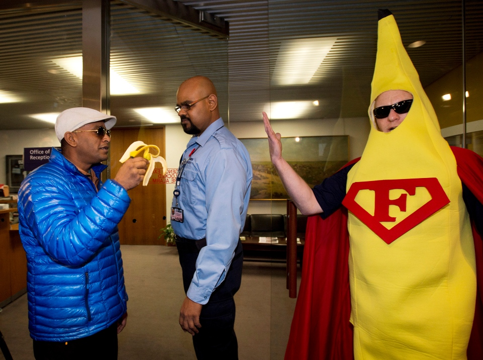 Chaos erupts at Toronto City Hall<br><br> A man dressed as a banana reacts outside the office of Toronto Mayor Rob Ford as security asks a man to leave on Friday, Nov. 8, 2013. Cameras have followed the mayor around like shadow, and some unusual characters have showed up at city hall ever since the mayor admitted to smoking crack cocaine. (Nathan Denette / THE CANADIAN PRESS)