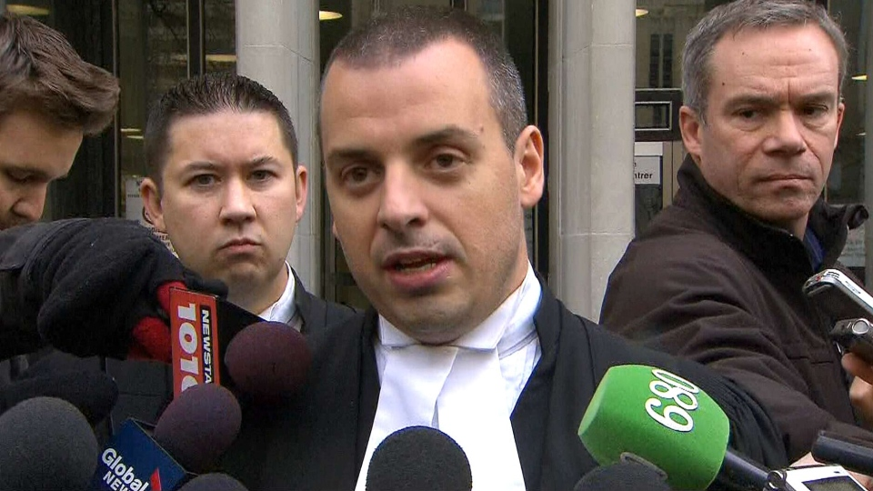 Nathan Gorham, lawyer for Muhammad Khattak, speaks to reporters outside a courthouse in Toronto, Friday, Nov. 8, 2013.