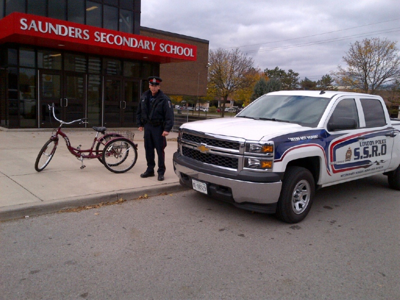 London police provided this photo of Secondary School Resource Officer Carl Noel with the trike that was presented to the student on Friday, Nov. 8, 2013.