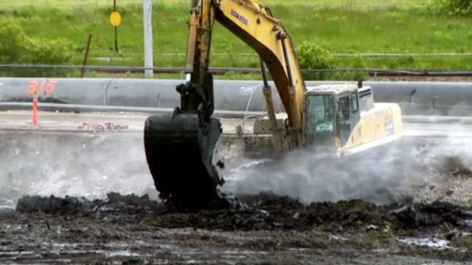 The toxic materials were mixed with cement and hardened into stone, then covered that with earth and sod.