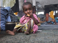 A child from southern Somalia eats a piece of bread inside a destroyed building in Mogadishu after fleeing from southern Somalia, Monday, July 11, 2011. The drought in the Horn of Africa has sparked a severe food crisis. More than 10 million people are now affected in drought-stricken areas of Djibouti, Ethiopia, Kenya, Somalia and Uganda and the situation is deteriorating. (AP / Farah Abdi Warsameh)