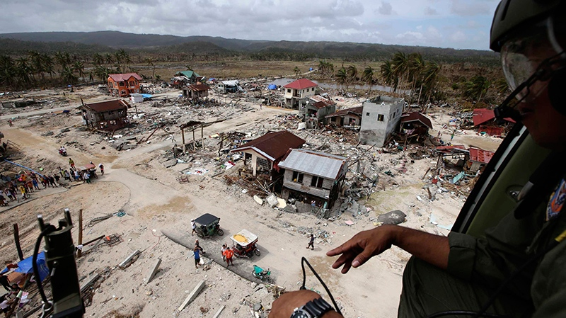 An aerial image taken from a Philippine Air Force helicopter shows the devastation caused by Typhoon Haiyan in Hernani township, Eastern Samar province, central Philippines, Monday, Nov. 11, 2013. (AP / Bullit Marquez)