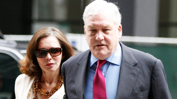 Conrad Black arrives at Federal Courthouse with his wife Barbara Amiel, Friday, June 24, 2011 in Chicago. Black, 66, once one of the world's most powerful media moguls, will appear in court for his re-sentencing hearing on two fraud convictions, where a judge will decide whether he heads back behind bars or remains free for good. (AP / Kiichiro Sato)
