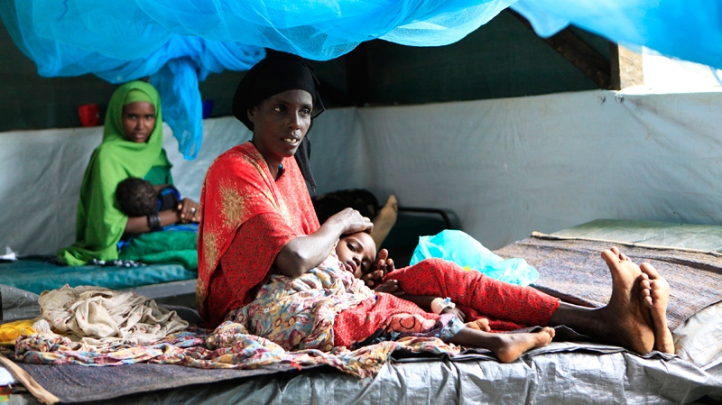 Somali women soothe their children, who are receiving treatment for malnutrition, at a Doctors Without Borders hospital in Dagahaley Camp, outside Dadaab, Kenya, Monday, July 11, 2011.  (AP / Rebecca Blackwell)