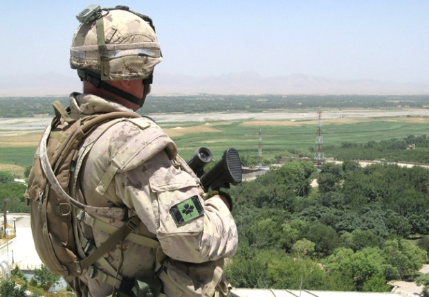 A Canadian soldier surveys the scene along the Arghandab River, near Kandahar city. (Alexander Panetta / THE CANADIAN PRESS)